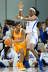 Kentucky forward Evelyn Akhator, right, puts ball pressure on Tennessee guard Te'a Cooper in the first half.<br /> <br /> The University of Kentucky hosted the University of Tennessee, Monday, Jan. 25, 2016 at Memorial Coliseum in Lexington .