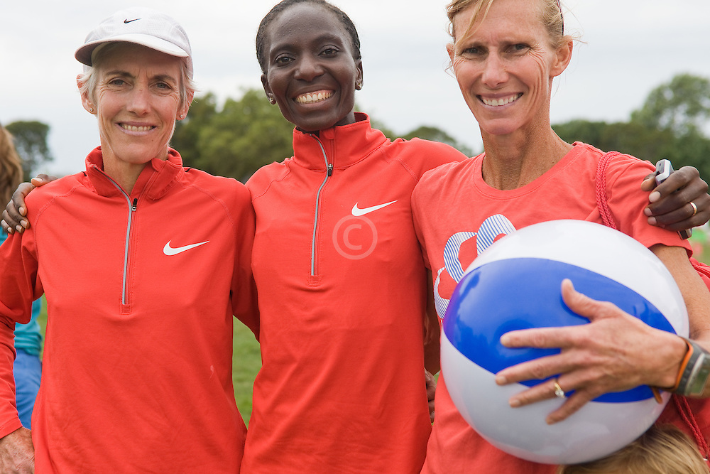 legendary elite runners Joan Benoit Samuelson, Catherine Ndereba, Colleen DeReuck after race