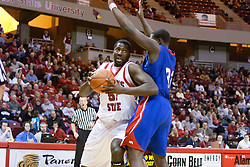 02 December 2006: Big Ronnie Carlwell ducks trying to get past Anthony Vereen. In a non-conference game, the Mavericks of University of Texas at Arlington lost to the Redbirds home 86-61. The win was the 5th in a row for the Redbirds, the longest winning streak in 6 years. the game was played at Redbird Arena in Normal Illinois on the campus of Illinois State University.<br />