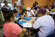 """18 AUGUST 2012 - PHOENIX, AZ: People at a deferred action workshop in Phoenix. More than 1000 people attended a series of 90 minute workshops in Phoenix Saturday on the """"deferred action"""" announced by President Obama in June. Under the plan, young people brought to the US without papers, would under certain circumstances, not be subject to deportation. The plan mirrors some aspects the DREAM Act (acronym for Development, Relief, and Education for Alien Minors), that immigration advocates have sought for years. The workshops were sponsored by No DREAM Deferred Coalition.  PHOTO BY JACK KURTZ"""