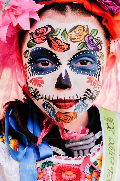 A young girl participates in a Dia de los Muertos pageant