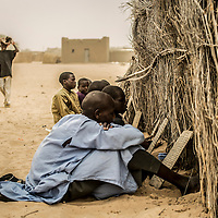 Baga Sola, Lake region, Chad.<br /> <br /> 30 Chadian students with their Imam fled Boko Haram violence in Baga, Nigeria. They were threatened and their Koranic school burnt because they did not want to integrate Boko Haram army.<br /> <br /> Sylvain Cherkaoui/Cosmos for MSF