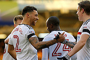 Fulham defender Ryan Fredericks (2) celebrates the own goal from Reading defender Chris Gunter (2) with teammates during the EFL Sky Bet Championship match between Fulham and Reading at Craven Cottage, London, England on 3 December 2016. Photo by Andy Walter.