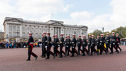 © Licensed to London News Pictures. 23/10/2016. London, UK. Trafalgar Day is celebrated by Sea Cadets with a ceremony in Trafalgar Square, followed by a march down The Mall and in front of Buckingham Palace (pictured).  Trafalgar Day celebrates the victory won by the Royal Navy, commanded by Vice-Admiral Horatio Nelson, over the combined French and Spanish fleets at the Battle of Trafalgar on 21 October 1805. Photo credit : Stephen Chung/LNP