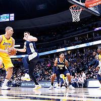09 March 2018: Denver Nuggets center Nikola Jokic (15) defends on Los Angeles Lakers center Brook Lopez (11) during the Denver Nuggets125-116 victory over the Los Angeles Lakers, at the Pepsi Center, Denver, Colorado, USA.