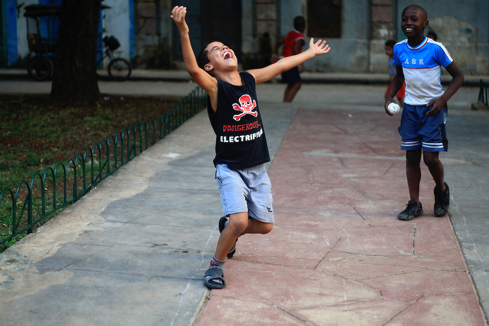 Young boys play baseball on the streets of Old Havana, Cuba.<br />
