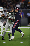 Miami Dolphins offensive tackle Ja'Wuan James (70) and Houston Texans defensive end J.J. Watt (99) in action during the NFL week 8 regular season football game against the Houston Texans on Thursday, Oct. 25, 2018 in Houston. The Texans won the game 42-23. (©Paul Anthony Spinelli)