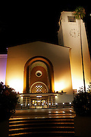 28 July 2005:  Amtrak SurfLiner train from Anaheim to Santa Barbara, CA.  Union Station where trains and people make connections. Exterior building shot at night.  Los Angeles Landmark downtown.