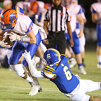 North Pontotoc receiver Ethan Dyer avoids the tackle from Booneville's Camron Young in the first quarter.