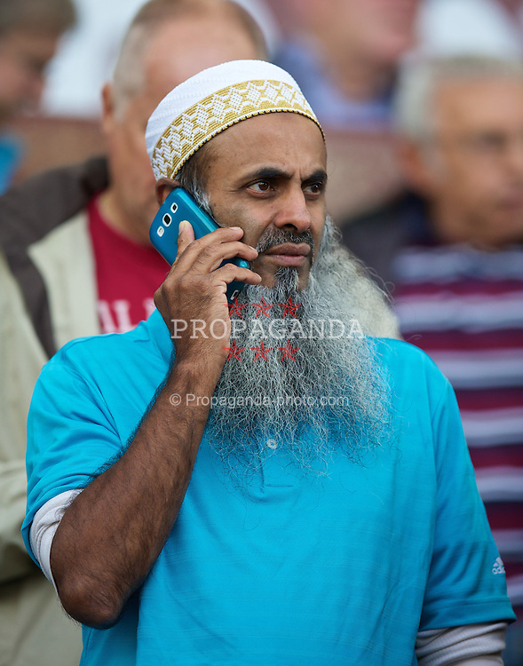 LIVERPOOL, ENGLAND - Saturday, August 24, 2013: An Aston Villa supporter during the Premiership match at Villa Park. (Pic by David Rawcliffe/Propaganda)