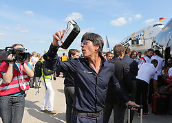 15.07.2014, Flughafen Tegel, Berlin, GER, FIFA WM, Empfang der Weltmeister in Deutschland, Finale, im Bild Bundestrainer Joachim Loew (GER) am Mannschaftsbus. // during Celebration of Team Germany for Champion of the FIFA Worldcup Brazil 2014 at the Flughafen Tegel in Berlin, Germany on 2014/07/15. EXPA Pictures © 2014, PhotoCredit: EXPA/ Eibner-Pressefoto/ Eibner Pressefoto / pool<br /> <br /> *****ATTENTION - OUT of GER*****