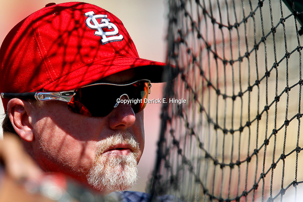 March 17, 2012; Lakeland, FL, USA; St. Louis Cardinals batting coach Mark McGwire (25) watches batting practice before a spring training game against the Detroit Tigers at Joker Marchant Stadium. Mandatory Credit: Derick E. Hingle-US PRESSWIRE