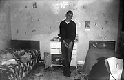 Gavin standing in front of his bedroom wall in Hawthorne Road, High Wycombe, UK, 1980s.
