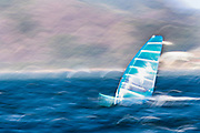 A slow shutter speed image shows an RS:X Mens windsurfer sailor sailing during a training session in Guanabara Bay in Rio de Janeiro, Brazil, 04 August 2016. Sailing events at 2016 Olympic Games start on 08 August.