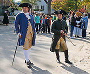 "Actors recreate characters of Colonial Williamsburg, the historic district of the independent city of Williamsburg, Virginia, which was colonial Virginia's capital from 1699 to 1780, and a center of education and culture. The capital straddled the boundary of two of the original shires of Virginia, James City Shire (now James City County), and Charles River Shire (now York County). Here, Thomas Jefferson, Patrick Henry, James Monroe, James Madison, George Wythe, Peyton Randolph, and dozens more helped mold democracy in the Commonwealth of Virginia and the United States. Motto: ""that the future may learn from the past.""  The Historic Area exhibits colonial houses and American Revolutionary War history. Prominent buildings in Colonial Williamsburg include the Raleigh Tavern, the Capitol, The Governor's Palace, and Bruton Parish Church. Interpreters work, dress, and talk as they did in the era, teaching visitors. The 301-acre Historic Area is located immediately east of the College of William and Mary, which was founded at Middle Plantation in 1693. The new College, long a desire of the colonists, was a key factor in the establishment of the town as capital of Virginia in 1698 and its renaming for King William III of England shortly thereafter.  Jamestown and Yorktown, the other two points of the Historic Triangle, are linked to Colonial Williamsburg by the National Park Service's bucolic Colonial Parkway. For licensing options, please inquire."