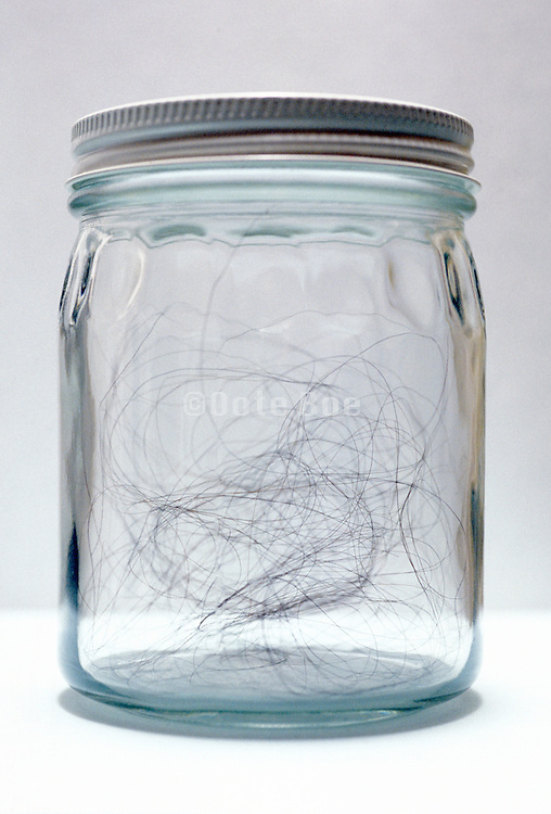 Long black hair in a glass jar.