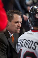 KELOWNA, CANADA - OCTOBER 4:  Karl Taylor, coach of the Portland Winterhawks listens to a player on the bench  at the Kelowna Rockets on October 4, 2013 at Prospera Place in Kelowna, British Columbia, Canada (Photo by Marissa Baecker/Shoot the Breeze) *** Local Caption ***