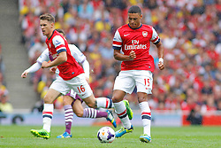 Arsenal's Aaron Ramsey and Alex Oxlade-Chamberlain in action  - Photo mandatory by-line: Mitch Gunn/JMP - Tel: Mobile: 07966 386802 17/08/2013 - SPORT - FOOTBALL - Emirates Stadium - London -  Arsenal V Aston Villa - Barclays Premier League