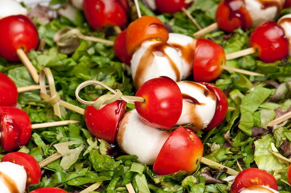Close up view of Mozzarella and tomato prepared for catering service.