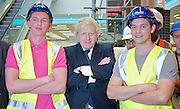 Boris Johnson <br /> The Mayor of London <br /> visits the Westfield Stratford Shopping development in Stratford, London, Great Britain <br /> 4th July 2011 <br /> Press Conference <br /> <br /> Boris Johnson <br /> with local apprentices<br /> apprentices L to R <br /> Ryan Marley <br /> Rob Taylor<br /> <br /> Photograph by Elliott Franks