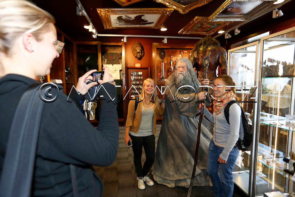 """Gandalf, the wizard, enthralls everyone, here in the Weta Cave, the showroom of the Weta Workshop, where the animations for the Hobbit movies are made, the first movie of the new trilogy  """"The Hobbit: An Unexpected Journey"""" starts in cinemas on 12 December 2012, the German tourists (from left) Lena Schuler, Anna-Maria Bachleitner and Lara-Marie Schwineköper take pictures with the magician"""