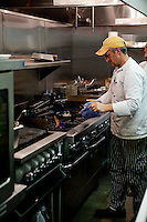 A chef prepares an entree for the dinner rush at The Block Restaurant in Webster Groves in St. Louis.