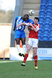 Bristol City's Brendan Moloney challenges Colchester United's Jabo Ibehre in the air - Photo mandatory by-line: Dougie Allward/JMP - Mobile: 07966 386802 22/03/2014 - SPORT - FOOTBALL - Colchester - Colchester Community Stadium - Colchester United v Bristol City - Sky Bet League One