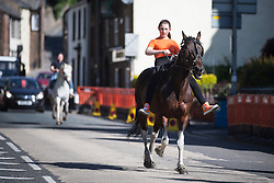 © Licensed to London News Pictures. 02/06/2016. Appleby UK. Today is the first day of the Appleby Horse Fair in the village of Appleby. The event see thousands of travellers bring their horses to be washed in the village river. Photo credit: Andrew McCaren/LNP