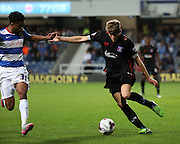 Patrick Brough in the build up to Carlisle United second and winning goal during the Capital One Cup match between Queens Park Rangers and Carlisle United at the Loftus Road Stadium, London, England on 25 August 2015. Photo by Matthew Redman.