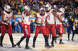 Nov 19, 2016; Morgantown, WV, USA; Oklahoma Sooners players celebrate after scoring a second quarter touchdown against the West Virginia Mountaineers at Milan Puskar Stadium. Mandatory Credit: Ben Queen-USA TODAY Sports