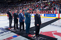 REGINA, SK - MAY 19: Derek Niedermayer of the Royal Canadian Legion standing at attention, Paul Brown of the Real Canadian Superstore, Mike Sillinger of the Regina Pats Alumni, Lieutenant Colonel Jody McKinnon of the Canadian Armed Forces standing at attention and Ron Robison of the WHL stand at centre ice for the ceremonial puck drop between the Acadie-Bathurst Titan and the Swift Current Broncos at the Brandt Centre on May 19, 2018 in Regina, Canada. (Photo by Marissa Baecker/CHL Images)