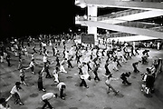 People dance at night in a square in Yichang