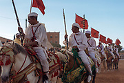 KELAAT M'GOUNA, MOROCCO - 13TH MAY 2016 - Horse riders from across Morocco perform at the 2016 Kelaat M'Gouna rose festival fantasia event, Kelaat M'Gouna, Dades and Tinghir Province of Southern Morocco.