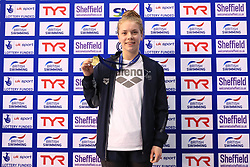 The medal ceremony for the women's 50m freestyle, gold medalist Anna Hopkin during day three of the 2017 British Swimming Championships at Ponds Forge, Sheffield.