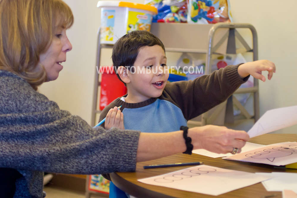 "Middletown, New York - A child works with a teacher during a ""Getting Ready for Kindergarten"" program at Thrall Library on Jan. 30, 2014."