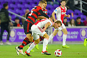 Flamengo midfielder Piris Da Motta (25) and Ajax midefielder Dani De Wit (30) fight for a ball during a Florida Cup match at Orlando City Stadium on Jan. 10, 2019 in Orlando, Florida. <br /> Flamengo won in penalties 4-3.<br /> <br /> ©2019 Scott A. Miller