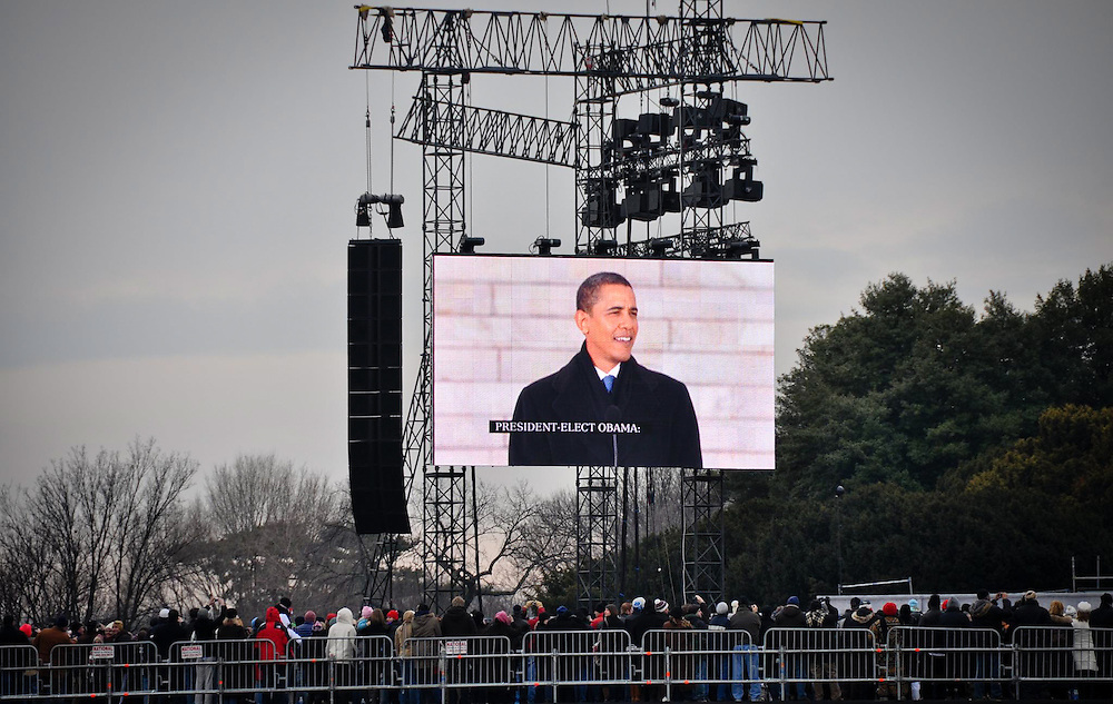 "Thousands watch on the JumboTron as President-elect Barack Obama speaks in front of the Lincoln Memorial during the ""We Are One: The Obama Inaugural Celebration At The Lincoln Memorial"" on January 18, 2009 at the National Mall in Washington, DC."