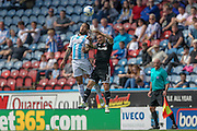 Sean Scannell (Huddersfield Town) and Sam Saunders (Brentford) jump for the ball during the Sky Bet Championship match between Huddersfield Town and Brentford at the John Smiths Stadium, Huddersfield, England on 7 May 2016. Photo by Mark P Doherty.