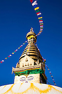 Prayer flags flap in the early morning wind at the Swoyambhunath Temple (Monkey Temple) in Kathmandu, Nepal.