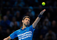 Tennis - 2019 Nitto ATP Finals at The O2 - Day One<br /> <br /> Singles Group Bjorn Borg: Novak Djokovic vs. Matteo Berrettini<br /> <br /> Novak Djokovic (Serbia) serving at the o2 Arena<br /> <br /> COLORSPORT/DANIEL BEARHAM
