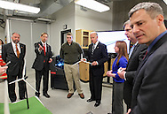 Iowa State College of Engineering Dean Jonathan Wickert (second on left) explains their student's project to Vice President Joe Biden as he takes a tour of the Make to Innovate lab at Iowa State University in Ames, Iowa on Thursday, March 1, 2012.