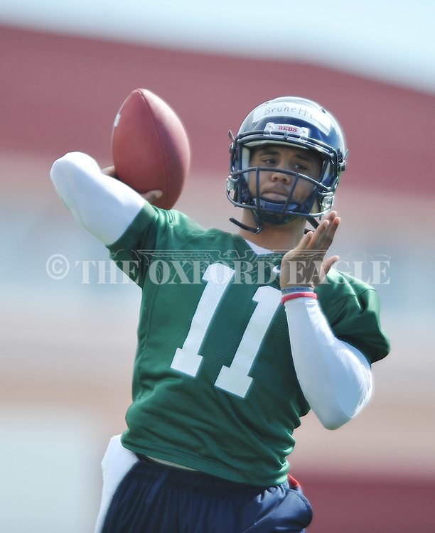 Quarterback Barry Brunetti goes through a drill as Mississippi began spring practice in Oxford, Miss. on Friday, March 23, 2012. (AP Photo/Oxford Eagle, Bruce Newman)