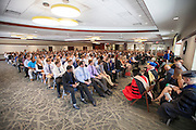 Freshman listen to speakers during the College of Business Freshman Convocation in Nelson Commons on Saturday, August 22, 2015. Photo by Kaitlin Owens