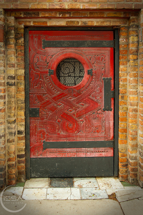 Wooden classic red door with metal frame in Chicago