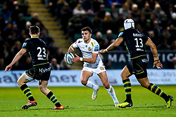 Henry Slade of Exeter Chiefs takes on Luther Burrell of Northampton Saints and Fraser Dingwall of Northampton Saints - Mandatory by-line: Robbie Stephenson/JMP - 28/12/2018 - RUGBY - Franklin's Gardens - Northampton, England - Northampton Saints v Exeter Chiefs - Gallagher Premiership Rugby