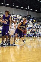 30 December 2006: Drew Yancey leans out to pass. The Titans outscored the Britons by a score of 94-80. The Britons of Albion College visited the Illinois Wesleyan Titans at the Shirk Center in Bloomington Illinois.<br />