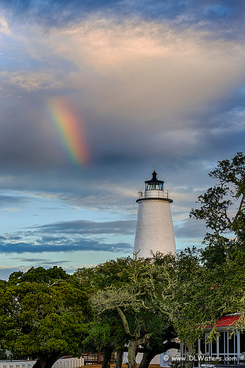 Ocracoke Lighthouse and a rainbow as the morning storm clears.