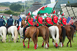 © Licensed to London News Pictures. 21/07/2015. Llanelwedd, UK. The Welsh team came third. Teams of riders take part in theRoyal Welsh Mounted Games – International World Team Championships. The Royal Welsh Show is hailed as the largest & most prestigious event of it's kind in Europe. In excess of 200,000 visitors are expected this week over the four day show period - 2014 saw 237,694 visitors, 1,033 tradestands & a record 7,959 livestock exhibitors. The first ever show was at Aberystwyth in 1904 and attracted 442 livestock entries. Photo credit: Graham M. Lawrence/LNP