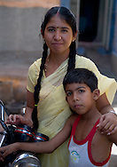 A mother and son in the blue city area of Jodhpur, Rajasthan, India