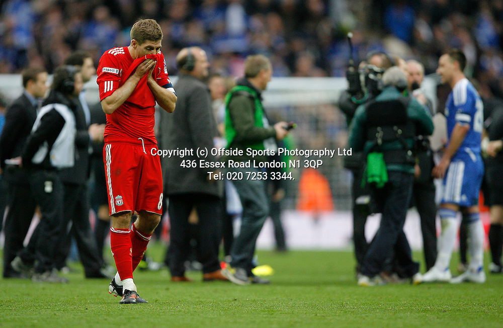 05/05/2012 FA Cup Final. Chelsea v Liverpool<br /> Liverpool captain Steven Gerrard is dejected as Chelsea captain John Terry is interviewed after the match.<br /> Photo: Mark Leech.